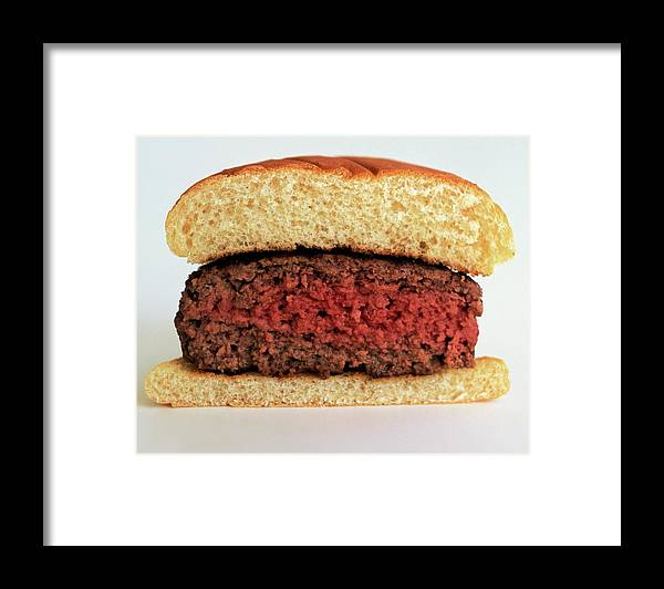 Cooking Framed Print featuring the photograph A Rare Hamburger by Romulo Yanes