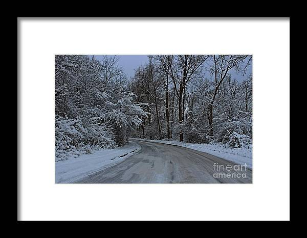Road Framed Print featuring the photograph A Road In Winter. by Dipali S