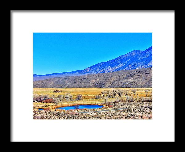 White Mountains Framed Print featuring the photograph A Road Runs Beside It by Marilyn Diaz