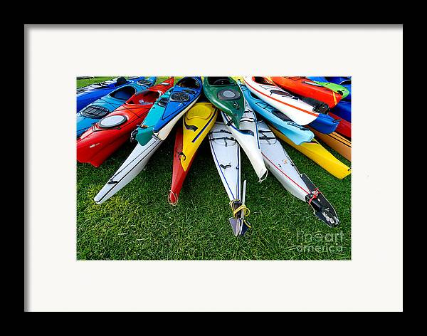 A Lot Framed Print featuring the photograph A Stack Of Kayaks by Amy Cicconi