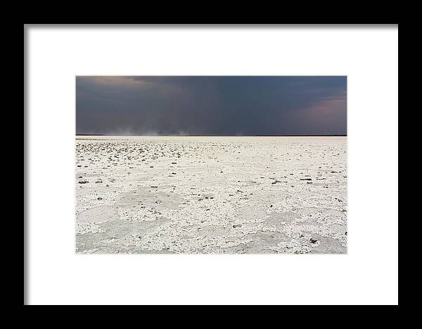 Salt Basin Framed Print featuring the photograph A Storm Approaching The Salt Pan by Sergio Pitamitz