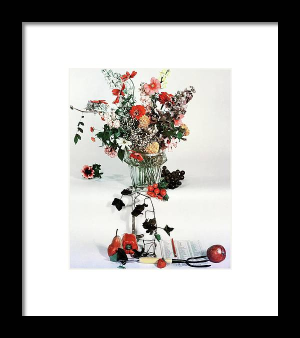 Nobody Framed Print featuring the photograph A Studio Shot Of A Vase Of Flowers And A Garden by Herbert Matter