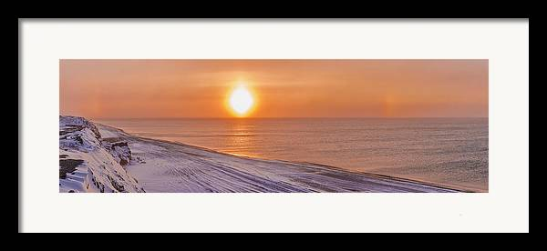 Arctic Framed Print featuring the photograph A Sundog Hangs In The Air Over The by Kevin Smith
