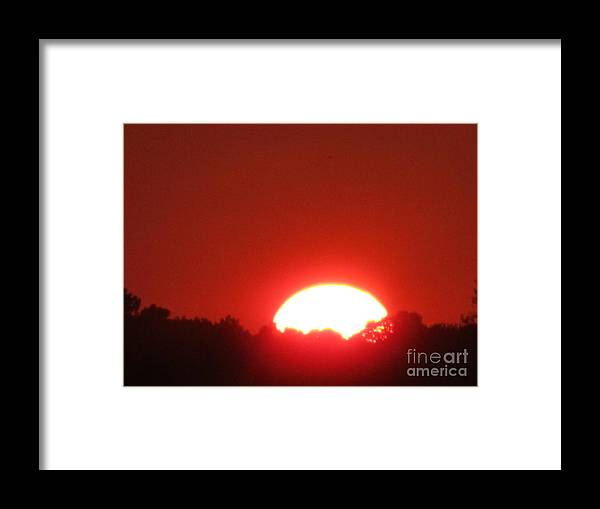 Sun Framed Print featuring the photograph A Very Hot Sunset by Tina M Wenger