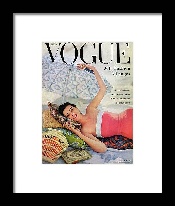 Fashion Framed Print featuring the photograph A Vogue Cover Of Anne Gunning Under An Umbrella by Karen Radkai
