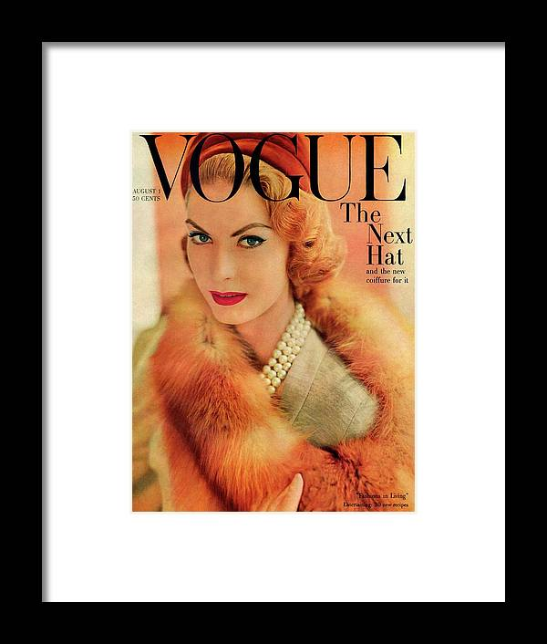 Fashion Framed Print featuring the photograph A Vogue Cover Of Mary Mclaughlin Wearing A Fox by Horst P. Horst