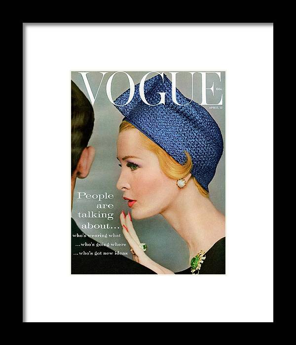 Fashion Framed Print featuring the photograph A Vogue Cover Of Sarah Thom Wearing A Blue Hat by Richard Rutledge