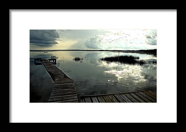 Seascape Framed Print featuring the photograph A Walk Into The Closing Day by Norman Johnson