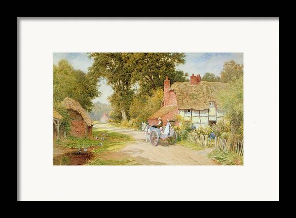Horse And Cart; Thatched Cottage; Thatch; Half-timbered; Country Lane; Rural; Duck Pond; Ducks; Victorian; Countryside Framed Print featuring the painting A Warwickshire Lane by Arthur Claude Strachan