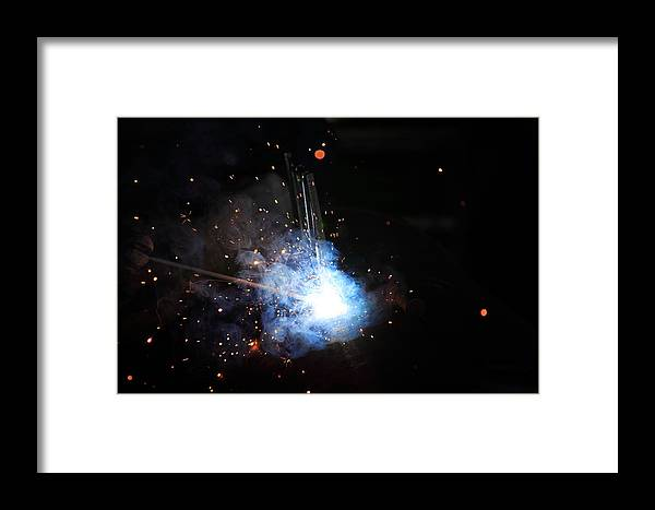 Welder Framed Print featuring the photograph A Welder's Universe by Daniel Alcocer