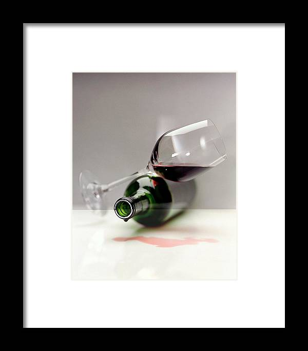 Beverage Framed Print featuring the photograph A Wine Bottle And A Glass Of Wine by Romulo Yanes