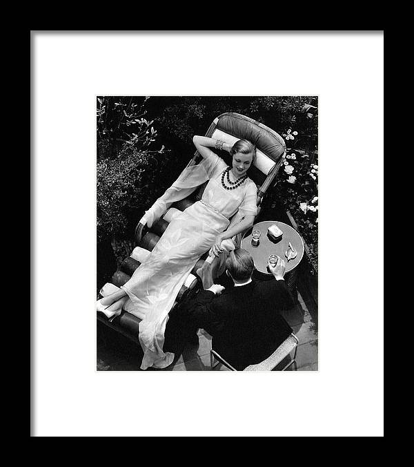 Fashion Framed Print featuring the photograph A Woman In A Chiffon Tea Gown In A Chaise Longue by The 3