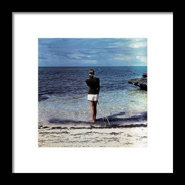 Fashion Framed Print featuring the photograph A Woman On A Beach by Serge Balkin