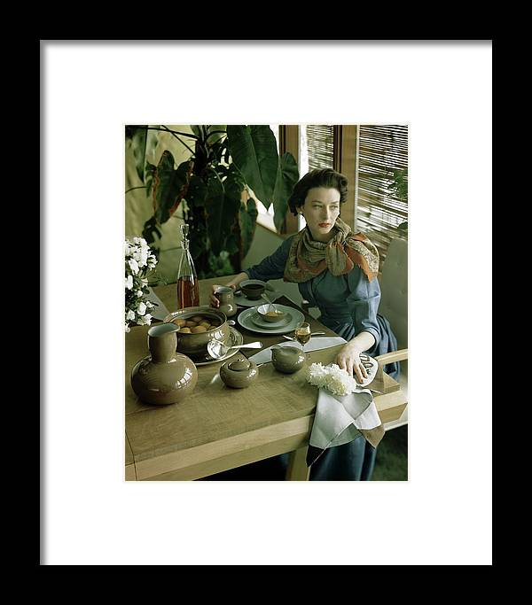 Table Setting Framed Print featuring the photograph A Woman Sitting At A Dining Table by Horst P. Horst