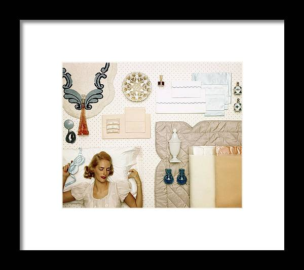 Bedroom Framed Print featuring the photograph A Woman Sleeping Next To An Assorted Range by Geoffrey Baker