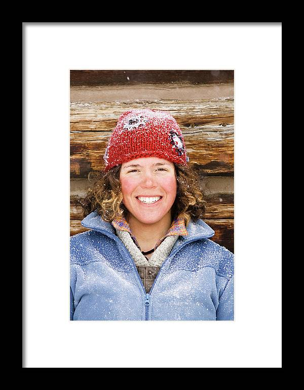 Adventure Framed Print featuring the photograph A Woman Stands Against A Log Cabin by Corey Hendrickson