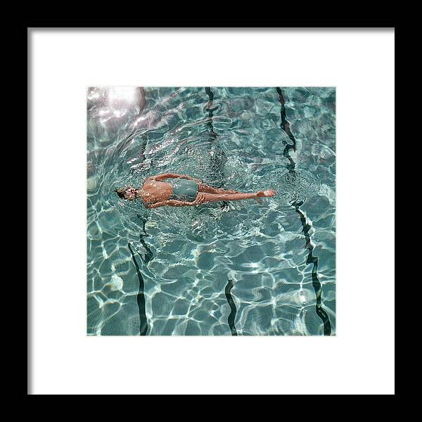 Water Framed Print featuring the photograph A Woman Swimming In A Pool by Fred Lyon