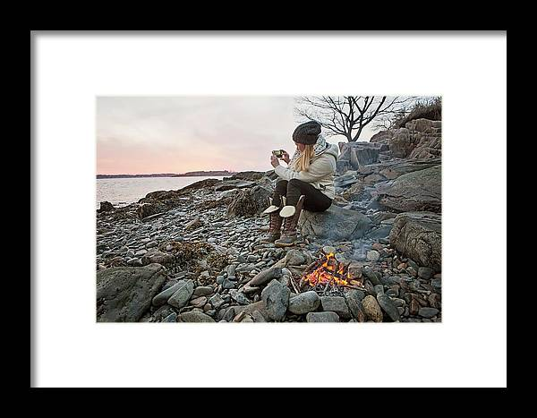 Bare Tree Framed Print featuring the photograph A Woman Takes A Cell Phone Picture by Chris Bennett