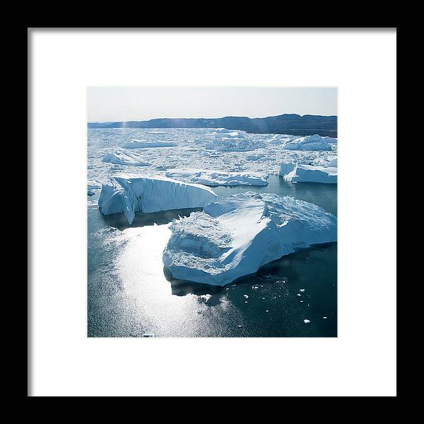 Melting Framed Print featuring the photograph Aerial Of Icebergs Of Ilulissat by Holger Leue