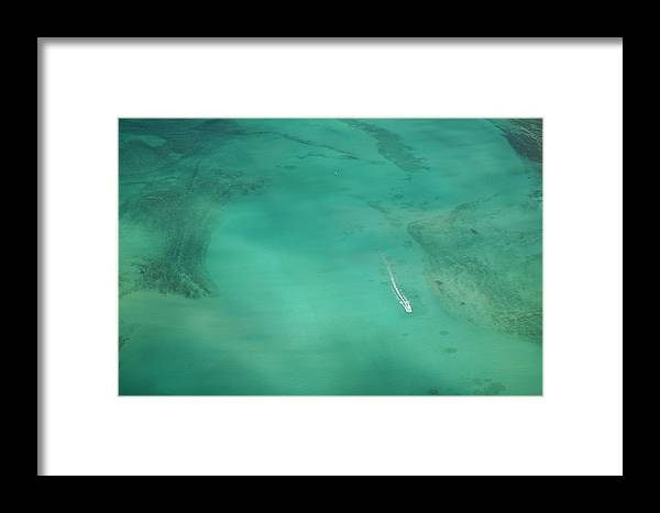 Tranquility Framed Print featuring the photograph Aerial Of Turquoise Waters With Passing by Merten Snijders