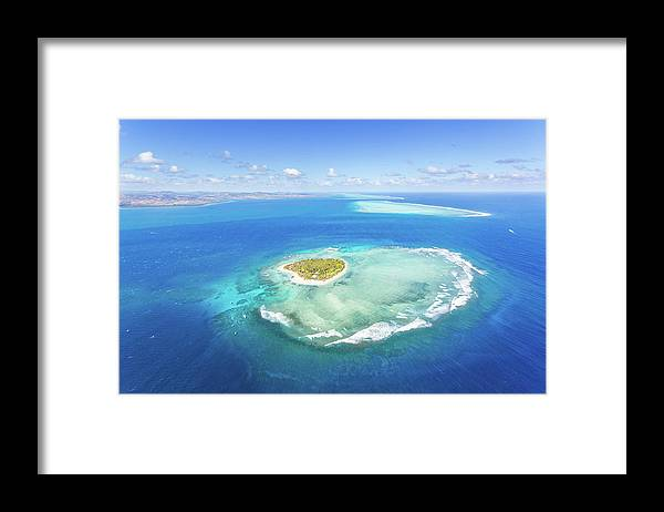 Tranquility Framed Print featuring the photograph Aerial View Of Heart Shaped Island by Matteo Colombo