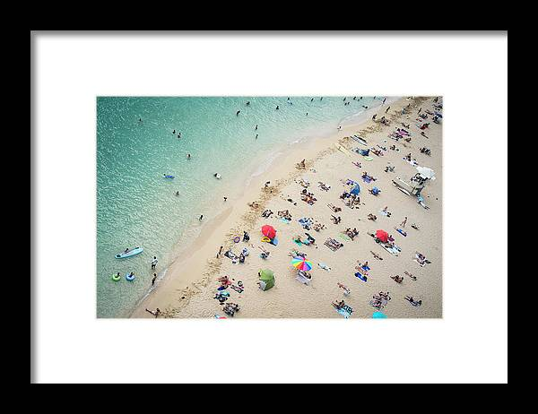 Honolulu Framed Print featuring the photograph Aerial View Of Tourists On Beach by Alberto Guglielmi