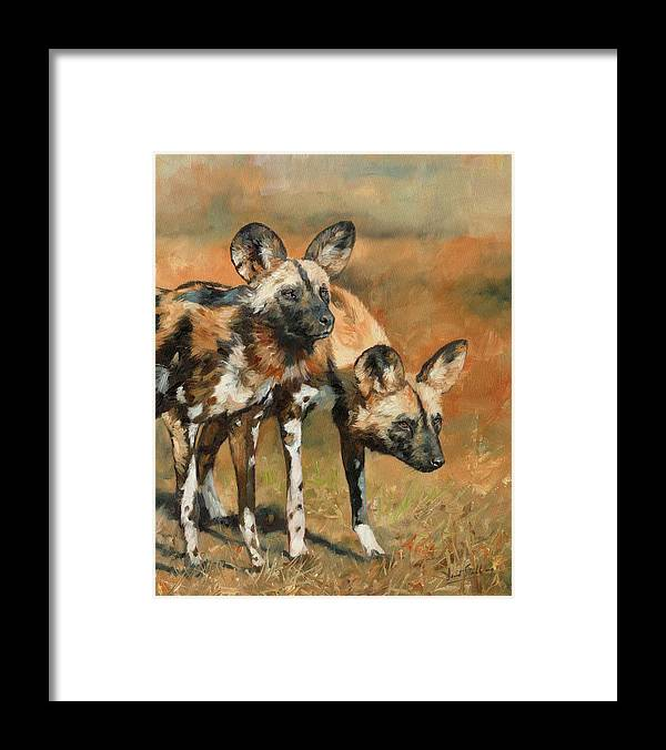 Wild Dogs Framed Print featuring the painting African Wild Dogs by David Stribbling