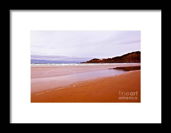 Agate Beach Oregon Framed Print featuring the photograph Agate Beach Oregon With Yaquina Head Lighthouse by Artist and Photographer Laura Wrede