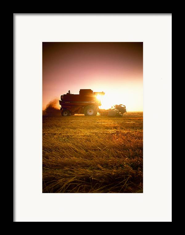 Country Framed Print featuring the photograph Agriculture - A Combine Harvests Wheat by Mirek Weichsel