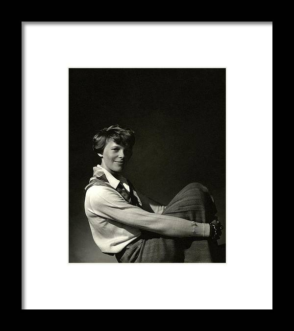 Aviation Framed Print featuring the photograph Amelia Earhart Hugging Her Knees by Edward Steichen