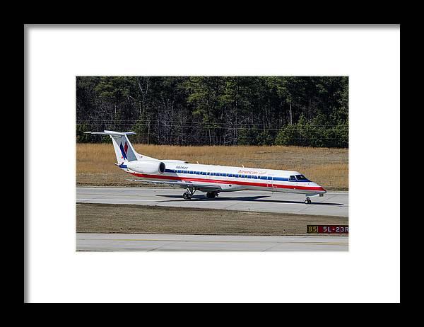 Framed Print featuring the photograph American Eagle ERJ-145LR by Richard Jack-James