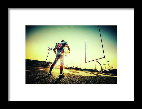 Headwear Framed Print featuring the photograph American Football Player by Ferrantraite
