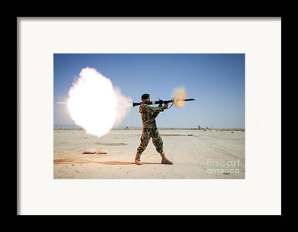 Coalition Forces Framed Print featuring the photograph An Afghan National Army Soldier Fires by Stocktrek Images