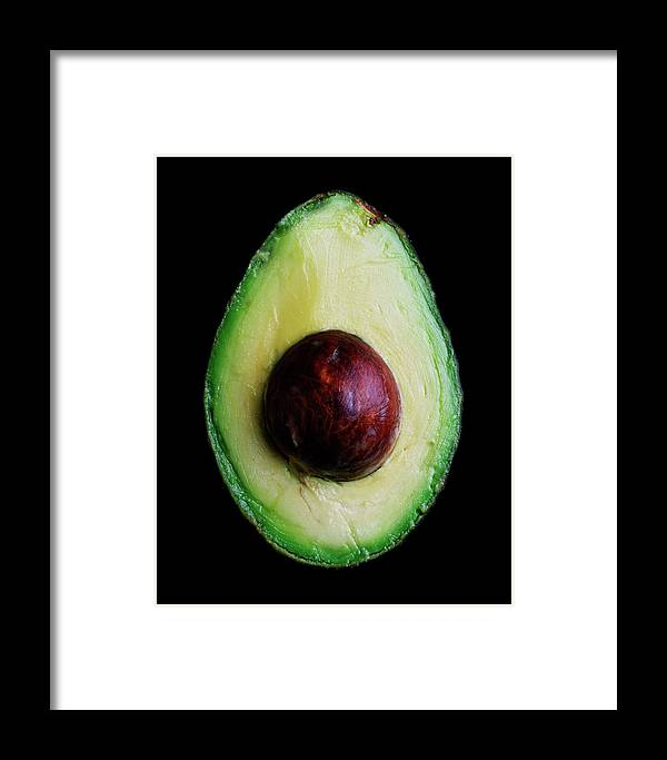 Fruits Framed Print featuring the photograph An Avocado by Romulo Yanes