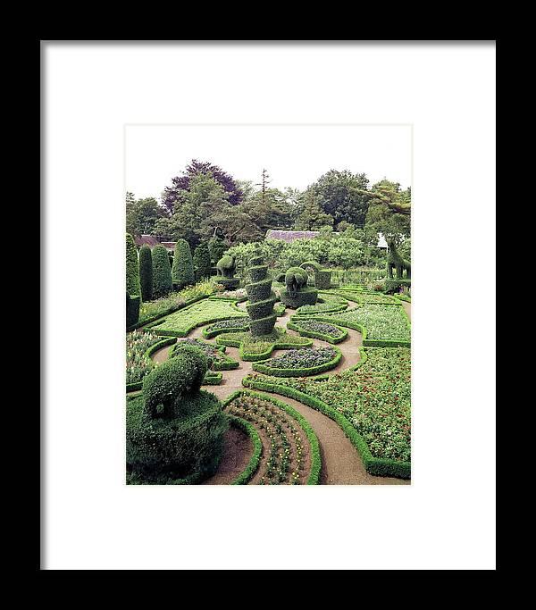 Exterior Framed Print featuring the photograph An Ornamental Garden by Tom Leonard