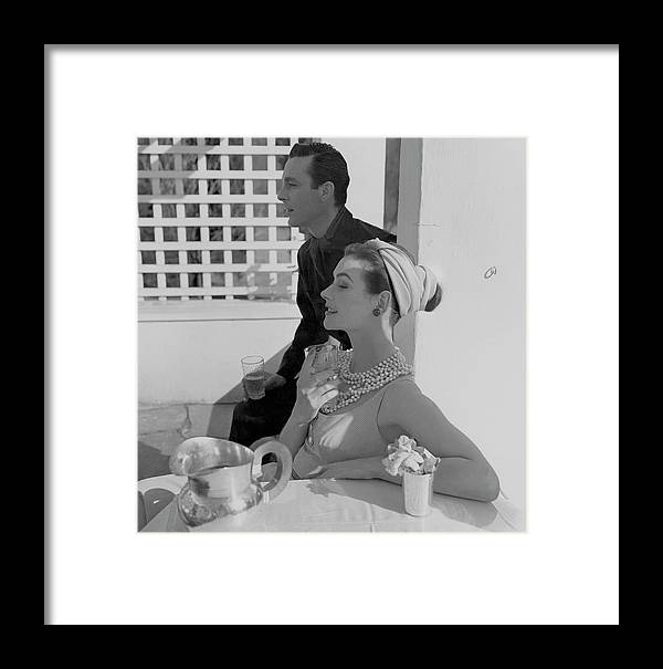 Daytime Framed Print featuring the photograph Anne Gunning Parker Sitting With A Man by Horst P. Horst