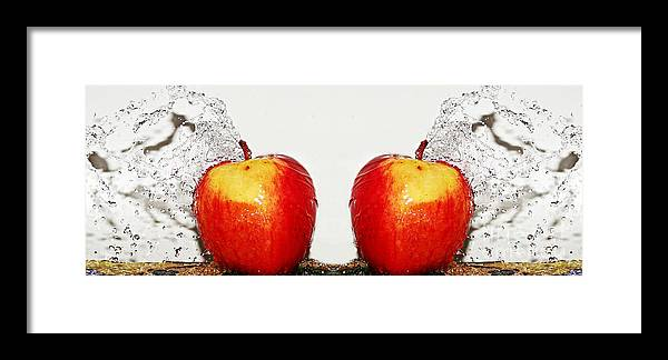Splash Framed Print featuring the photograph Apple Splashes. by Dipali S