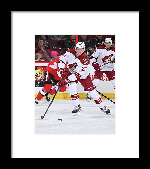 National Hockey League Framed Print featuring the photograph Arizona Coyotes V Ottawa Senators by Andre Ringuette