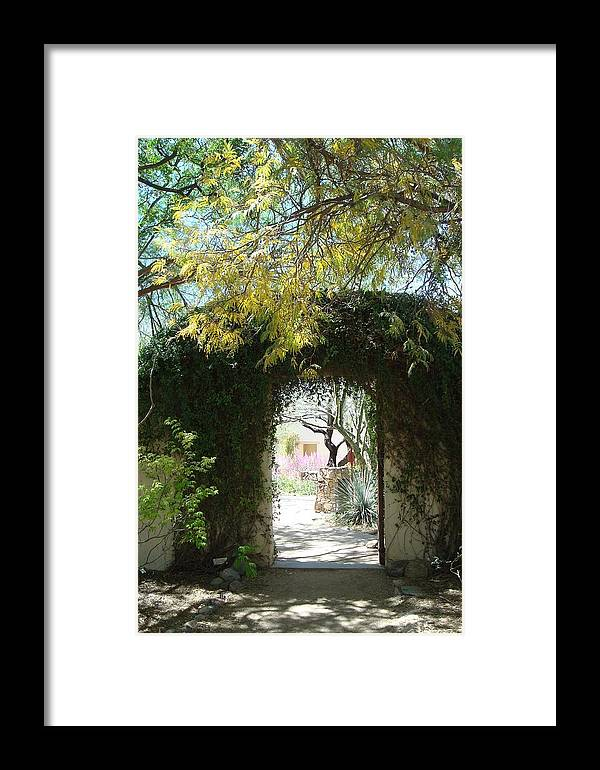 Arched Gateway Framed Print featuring the photograph At Tohono Chul by Susan Woodward