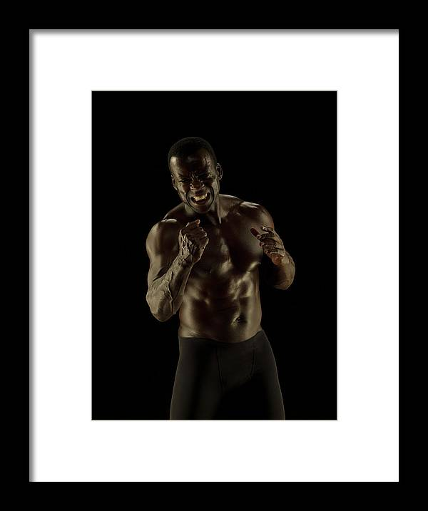 Toughness Framed Print featuring the photograph Athletic Female, Angry Shout, Clenched by Jonathan Knowles