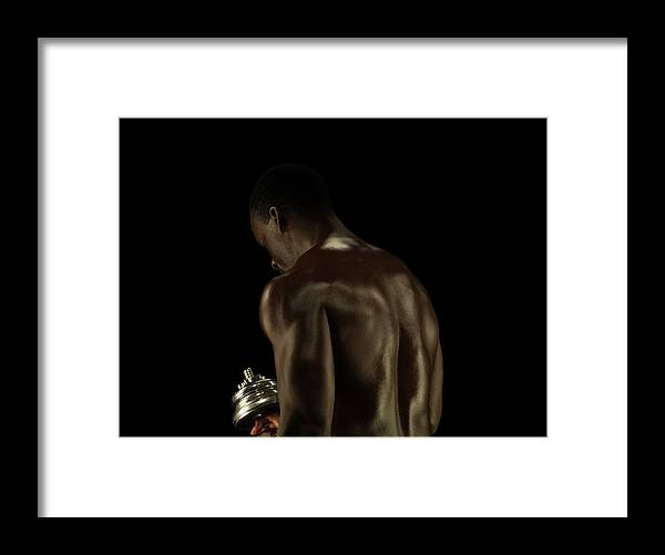 Mature Adult Framed Print featuring the photograph Athletic Male Exercising With A Hand by Jonathan Knowles