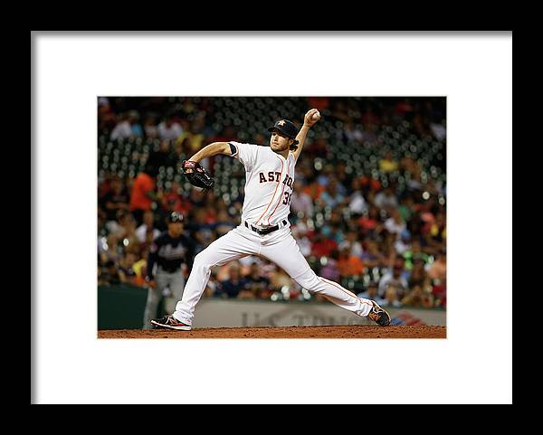 American League Baseball Framed Print featuring the photograph Atlanta Braves V Houston Astros by Scott Halleran