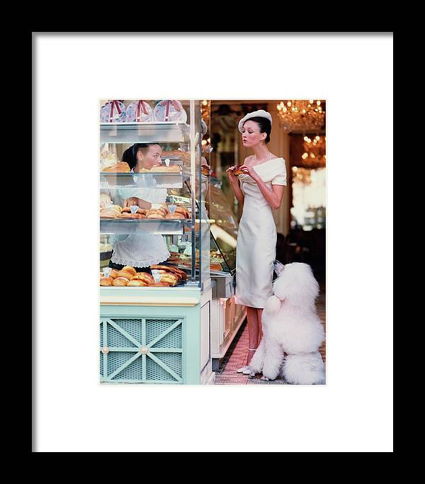 Accessories Framed Print featuring the photograph Audrey Marnay At A Patisserie With A Poodle by Arthur Elgort