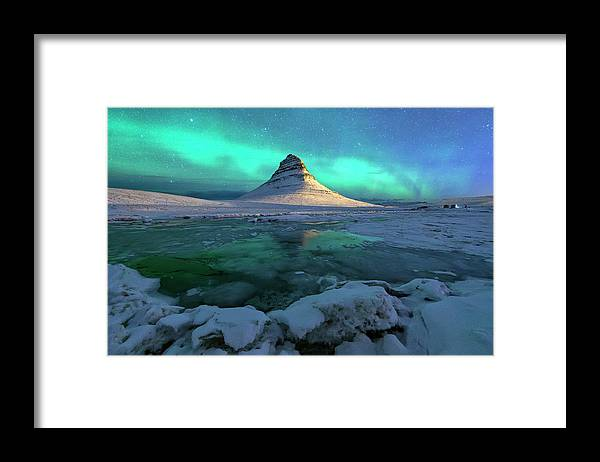 Tranquility Framed Print featuring the photograph Aurora Over Kirkjufell Mountain Iceland by Ratnakorn Piyasirisorost