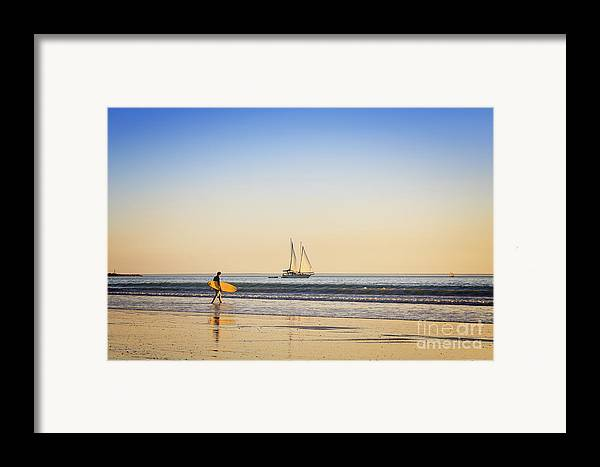 Ambience Framed Print featuring the photograph Australia Broome Cable Beach Surfer And Sailing Ship by Colin and Linda McKie