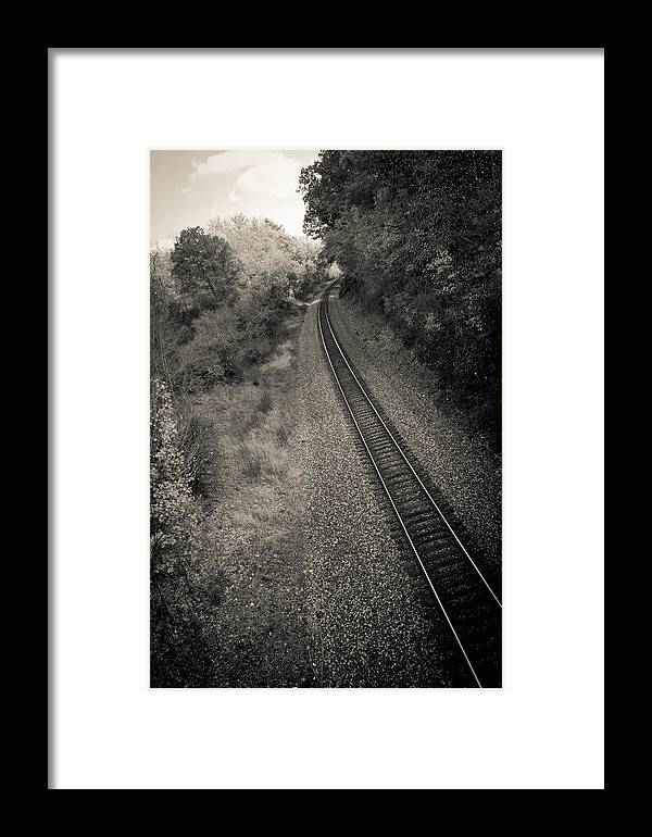 Train Framed Print featuring the photograph Away From Here by Off The Beaten Path Photography - Andrew Alexander