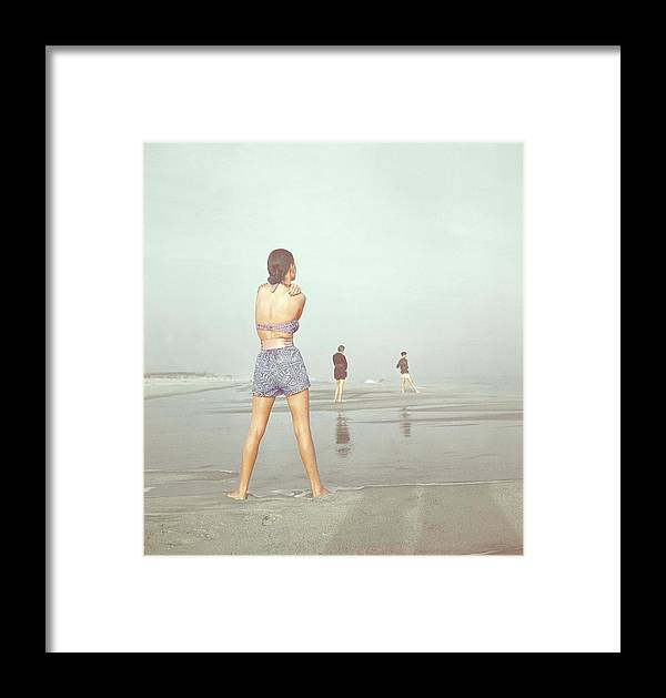 Fashion Framed Print featuring the photograph Back View Of Three People At A Beach by Serge Balkin