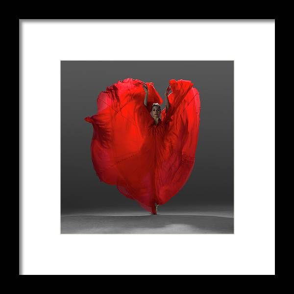 Ballet Dancer Framed Print featuring the photograph Ballerina On Pointe With Red Dress by Nisian Hughes
