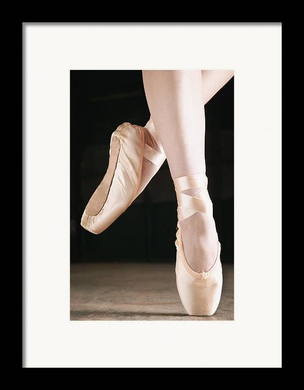 Pride Framed Print featuring the photograph Ballet Dancer En Pointe by Don Hammond