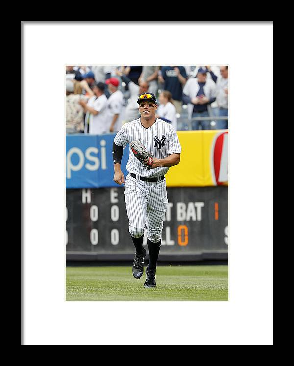 People Framed Print featuring the photograph Baltimore Orioles vs New York Yankees by Paul Bereswill